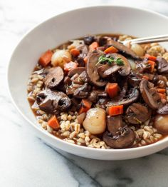 Mushroom Bourguignon... If you love mushrooms and cooking with red wine, this is the perfect dish for you! I used farro as a bed for my mushroom stew but you can use any pasta of choice, or serve over mashed or roasted potatoes. Delicous any way you serve it!