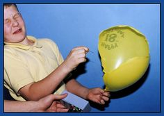 high speed photo of balloon popping