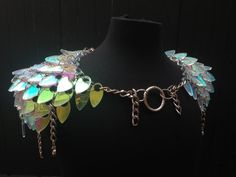 Laser cut and engraved acrylic scales are joined together with stainless steel jump rings to form these shoulder pieces. Fantastic style for men or women evokes ancient armor with modern adornment. Easily Adjustable chains make for easy fitting over clothes or not, and on any body type.  Get yours! https://www.etsy.com/listing/174659449/scale-shoulder-armor