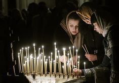 Lithuanian Orthodox Church believers light candles during the liturgy Chapel Veil, Black Veil, Votive Candles, Home Art, White Lace, Catholic, Give It To Me, Women Wear, Concert
