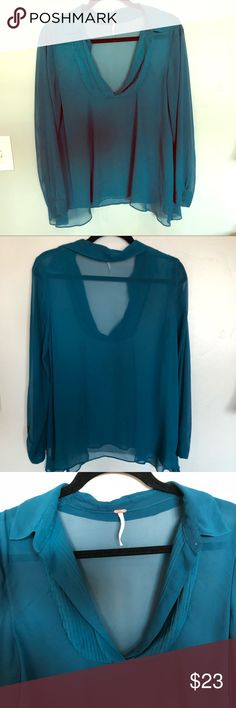 Lovely, Loose Fit Deep Blue Free People Blouse Very light and airy. Sheet and loose fitting.  Size small, but could easily fit medium and maybe even Large. The color is a deep blue/green Free People Tops Blouses