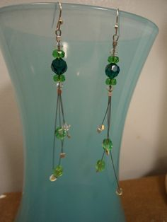 Emerald Swarovski Crystal & Peridot dangle earrings: handmade unique w/ Green Glass and Crystal accent beads. Silver plated Hooks. by ATouchOfT on Etsy