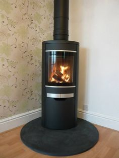 Fires Scan 58 woodburner in a corner wood burning stove installation in C., Kernow Fires Scan 58 woodburner in a corner wood burning stove installation in C., Kernow Fires Scan 58 woodburner in a corner wood burning stove installation in C. Corner Log Burner, Wood Burning Stove Corner, Wood Burning Logs, Modern Wood Burning Stoves, Corner Stove, Wood Stoves, White Wood Desk, Walnut Wood Floors, Stick On Wood Wall