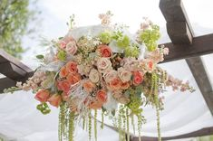 Peach And Chocolate Wedding | outdoor wedding ceremony arbor with peach ivory and blush pink flowers