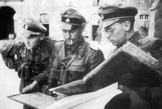 Standartenführer Peiper, telling his superior officers the right action with the map