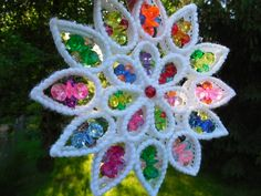Cheesy vintage suncatcher made from plastic canvas and translucent plastic beads. Fun!