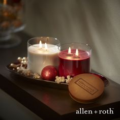 Add a warm glow with allen + roth holiday scented candles.