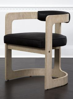 KELLY WEARSTLER   ZUMA DINING CHAIR. Constructed from bent plywood upholstered in supple textured leather.