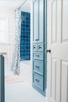 Blue Bathroom Duo – Amanda Louise Interiors Scallop Tiles, Mirror Drawers, Blue Bath, Linen Cabinet, Blue Tiles, Cabinet Makers, Tub, Locker Storage, Minimalism