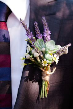 Lavender boutonniere succulent wrapped in twine.
