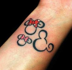 Mickey Mouse family  - I want a Micky tattoo. Never thought about just the ear/head outline. Hmmm