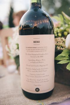 A printed menu on a wine bottle will also save room on the table. Hitch Sparrow Photography #weddingmenus #weddingreception