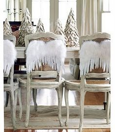 how cute, angel wings on the back of chairs