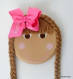 Hair bow holder. I use to have one of these when I was little