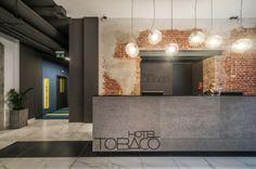 empfangsbereich, hinten rigipswand, abtrennung von den kreativen Tobaco Hotel by EC 5
