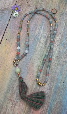 Mala necklace made of 6 and 8 mm - 0.236 and 0.315 inch, beautiful frosted jasper gemstones. Together they count as 108 beads. The mala is decorated with two Nepalese beads, hematite and a jade guru stone.  The total length of the mala is approximately 90 cm - 35.43 inch.
