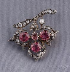Antique Pink Tourmaline and Diamond Clover Brooch, France, set with circular-cut pink tourmalines and rose-cut diamonds, seed pearl accent, silver-topped 18kt gold mount, lg. 1 in., partial maker's mark and guarantee stamps.