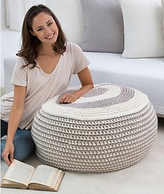 You'll love having this perfectly striped pouf around to lean on or to rest your feet. It can be crocheted very easily (even by a beginner) and then a child's bean bag chair is used for the stuffing.