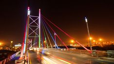Stock Footage of Static timelapse at night shooting down on the Nelson Mandela Bridge in the city centre of Johannesburg, South Africa during peak traffic time. Explore similar videos at Adobe Stock Night Shot, City Scene, Nelson Mandela, Travel And Tourism, Stock Video, Golden Gate Bridge, Night Time, Stock Footage, South Africa