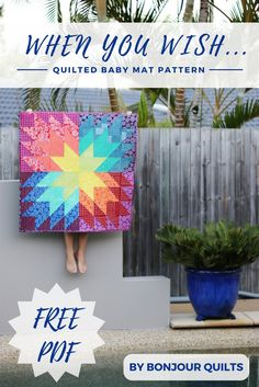 A free downloadable PDF pattern for a quilted baby mat by Kirsty of Bonjour Quilts. A quick, easy quilt pattern perfect for beginners. Give the gift of a rainbow to a new bub!