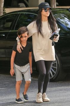 Kourtney Kardashian wearing Adidas x Kanye West Yeezy 350 Boost Sneakers in Oxford Tan, Yeezus Tour Cap, Saint Laurent Sl 93 Sunglasses and Ry400 Compression Long Tights For Recovery