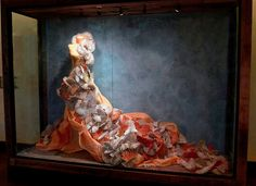 Love the display window (Anthropologie) - the beautiful finish against the orange is amazing.
