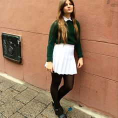 Employee Ebba from Sweden in the Tennis Skirt and Cropped Fisherman Pullover.