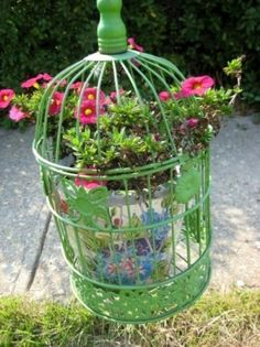 This birdcage has a flower pot inside...you can do this when the entire top of the cage opens up