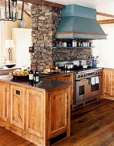 great kitchen Is the other side of the stove Agassi fireplace. I would do darker woods and a dark green vent