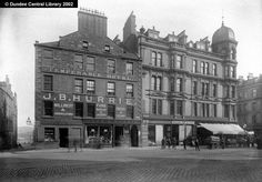 High Street, Dundee - Ref: WC0240    Crichton Street leads southwards to the left of this photograph, which shows the join of High Street (the building bearing J. B. Hurrie's name) and Nethergate, as well as the top of Whitehall Street.    Hurrie, despite the road sign on the front of the shop, is always given in the Dundee Directory as Nethergate. The business moved to new premises in July 1888.