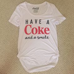 Have a Coke and a smile T-shirt Small New with tags. Have a Coke and a smile T-shirt Small. Tops Tees - Short Sleeve