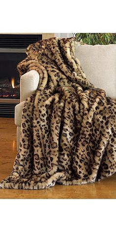 The cats and I like snuggling under absurd faux leopard blankets. This one would just take it up a notch.