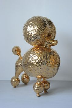 Gold art pieces like this poodle by Matt Wedel (2010) bring in a hint of glamour to a space. A budget friendly alternative is to spray paint objects with metallic paint.