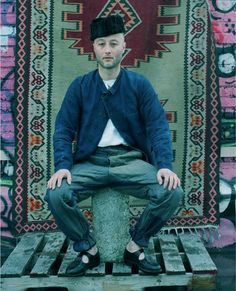 A well-travelled hipster, or a Central Asian with a very personal sense of style. I'm tilting towards the former.
