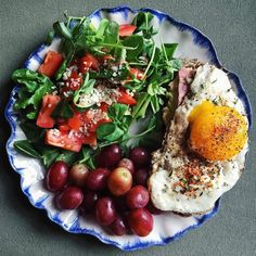 420-Dinner is a salad of pea shoots and other greens, tomatoes, Parmesan, and raspberry vinaigrette. Grapes. Toasted raisin pecan bread with jalapeño hummus, ham, and egg.