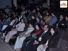 Eminent guests sitting at front row enjoying the event