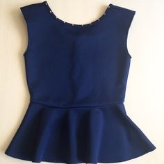 F21 Peplum Top Blue peplum top with chest stud lining and back zipper. Padded shoulders. 90% polyester. 10% spandex. Never worn. Fits me big since I am an XS Forever 21 Tops Blouses
