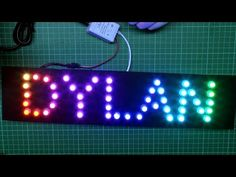 Multicoloured LEDs with integral control chips, prewired into sets of In this episode, the LEDs are fixed into black plastic panels to create seve. Electrical Projects, Led, Name Signs, Montage, Geek Stuff, Names, Programming, Board, Remote
