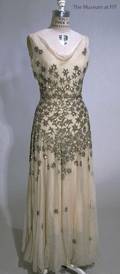 Evening dress in bias cut ivory silk chiffon by Mary Liotta, 1926, USA, Gift of Anna Hoss. Collection of The Museum at FIT #TurnofStyle