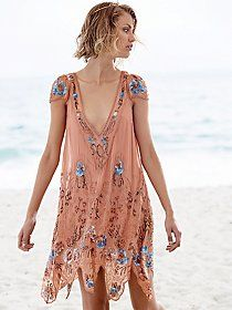 Write About Love Dress   Sheer chiffon long-sleeved dress with embroidered detailing. Upper portion and sleeves are dotted mesh. High neckline. Lined.