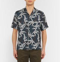 The bowling shirt has strong retro appeal and with its oriental bamboo and koi print, this Marc Jacobs version is a bold take on the style. Cut in a roomy, comfortable fit for a rakish look, it'll work well with a tailored jacket and trousers, or over shorts and sandals.