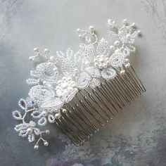 White pearl and French beaded flower bridal hair comb. Delicate and fine pearl flower wedding headdress accessory made with Swarovski crystals and pearls for a romantic wedding. Gorgeous headpiece for the bride or bridesmaids.  Unique, original design, handmade wedding hair accessory.  Width approx.