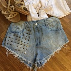 "Sexy Festival denim cut offs!! Studded cutoffs!! Super cute with raveled hem that has been stitched. Came from little boutique so there is no brand tag or size tag. Measurements are across waist 13"". No inseam...not enough to measure. Buyer note measurements bit listing as 0-1. Shorts Jean Shorts"