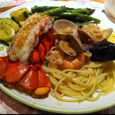 Lobster tail, seafood linguini, zucchini, and asparagus
