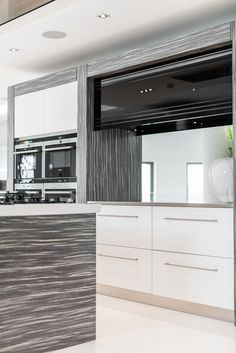 Modern kitchen with black glass feature from Herrington Gate