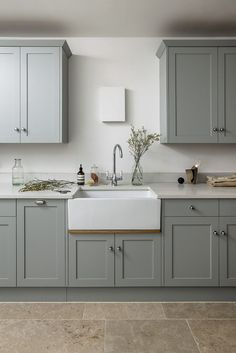 Clients of love a well appointed utility room. The designer's delightful country kitchens often feature an area customised to… Sage Kitchen, Rustic Kitchen, New Kitchen, Kitchen Decor, Kitchen Black, Kitchen Cupboard Colours, Green Kitchen Cabinets, Cupboard Design, Modern Farmhouse Kitchens