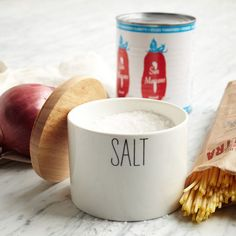 """From West Elm $9. Pass the salt. Our porcelain Labeled Kitchen Salt Box is finished with a smooth cream glaze finish. The wood lid keeps crystals fresh and moisture-free for when you need them. Cream glazed porcelain. 4""""diam x 3.3""""h. Hand wash. Imported."""