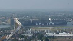 With an overall length feet and a beam, the ship stretches four football fields long, and has a capacity of TCUs, . Bayonne Bridge, Football Field, East Coast, Worlds Largest, Paris Skyline, Fields, Stretches, Ship, Travel