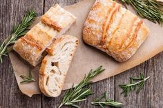 Traditional recipe for Ciabatta. Light, crusty on the outside, and porous on the inside, ciabatta is an omnipresent Italian bread whose oval, slightly elongated form resembles a slipper Pan Gourmet, Cut Out Carbs, Gluten Free Diet, Bagel, Baking Soda, Nutrition, Ethnic Recipes, Wooden Background, Side Effects