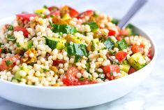How to make light and healthy couscous salad with a simple lemon vinaigrette, cucumber and herbs. Jump to the Easy Lemon and Herb Couscous Salad Recip Couscous Salad Recipes, Vegetable Salad Recipes, Healthy Salad Recipes, Vegetable Couscous, Couscous Healthy, Orzo Recipes, Greek Salad, Lemon Recipes, Chopped Salads